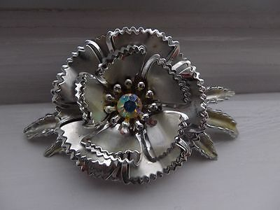 1950s pierced and layered silver-tone flower brooch.