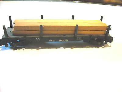 American #928 New Haven Flatcar with load.