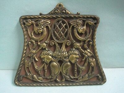 Antique wall plaque in bronze with a birds and two people