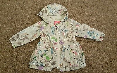 Gorgeous NEXT girls 6-9 months floral raincoat in great condition. Spring/Summer