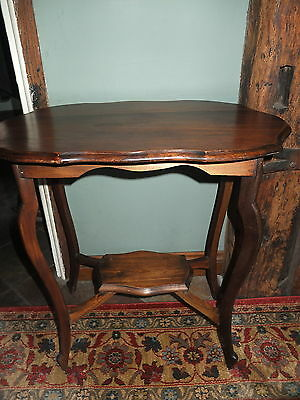 An Edwardian scallop edge mahogany topped occasional table