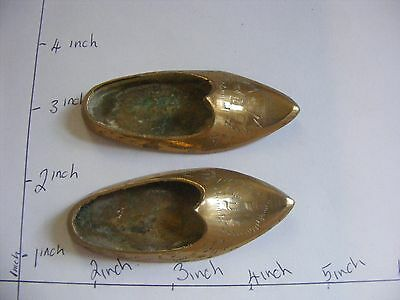 Vintage pair of miniature brass shoes