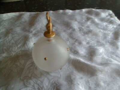 White frosted glass perfume bottle with a gold coloured pattern
