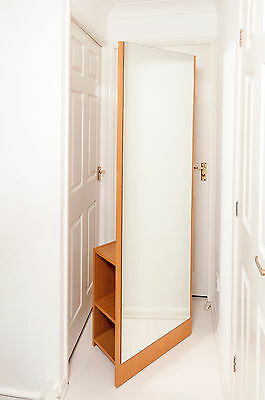Full-length mirror with clothes rail and shelves
