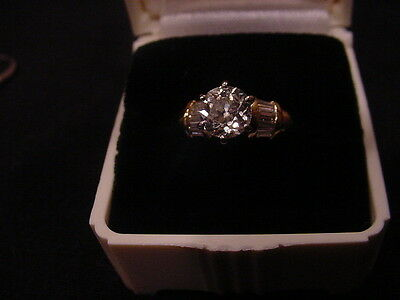 18 K gold and .96 diamond ring with 10 baguette diamonds