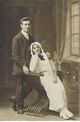 Handsome Couple Sitting On An Ornate Chair - Vintage Photo Postcard
