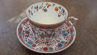 an antique crown derby cup and saucer