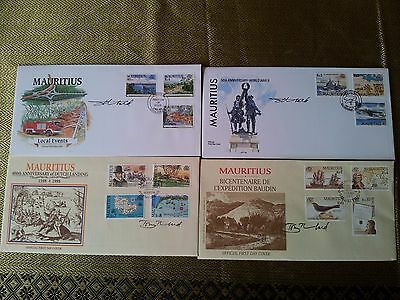 Four Mauritius First Day Covers signed by designer Tony Theobald.