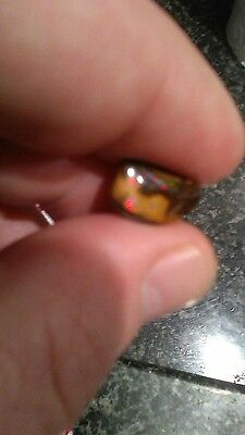 australian boulder opal, over 2 CTS great multi color pinfire,