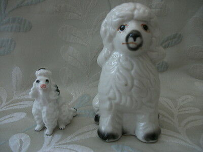 Two poodle figurines