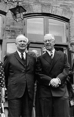 Vintage photo of Dwight D. Eisenhower standing with a man in the event.