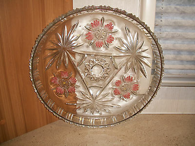 Glass dish with floral pattern.