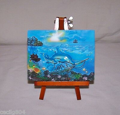 Dolphens  Swimming  Around A Shipwreck  Plaque On A Wooden Easel