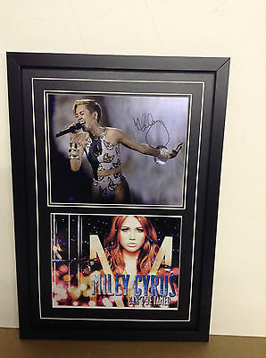 Miley Cyrus Genuine hand signed photograph with COA