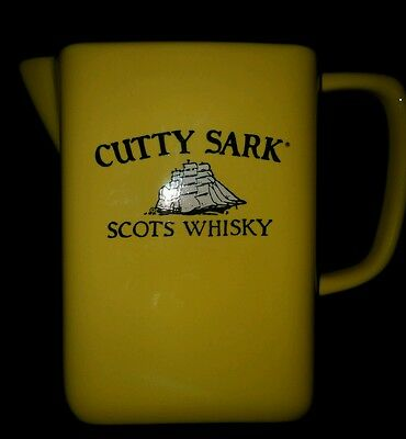 "Cutty Sark Scots Whisky Yellow Ceramic Pitcher 6"" tall 32oz. Mexico"