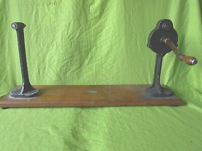 a vintage cinema spool film re-winder by Cinecraft......upcycle bookcase?