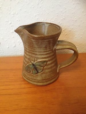Brown Unglazed Milk Jug with Butterfly Design from Weston Park. ¾ pint. VGC