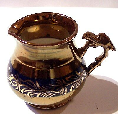 antique English early 19thc copper luster pottery blue band creamer bird handle