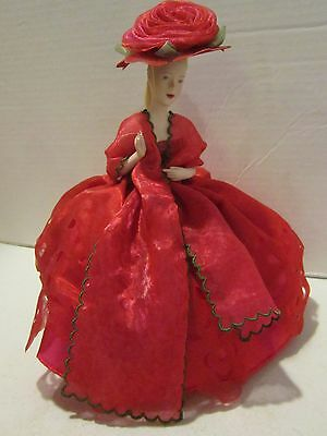 """Very nice bisque half doll pin cushion 9"""" girl in red gown  with hat EC"""
