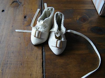 Reproduction shoes for an Antique or reproduction doll by Joyce Nicholson. 6cm
