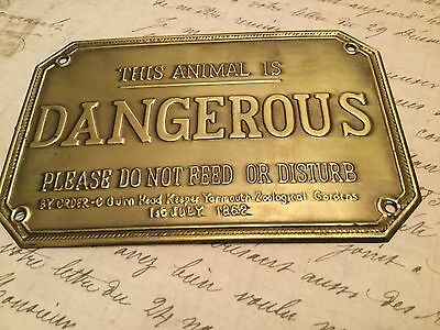 Rare brass sign DANGEROUS ANIMAL. Absolutely delightful and very collectable