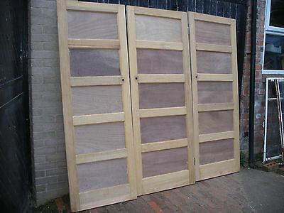 Reclaimed five panel 1930s to 1950s stripped pine doors.  (5 available)