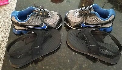 Boys Nike Training Blue No Tie Running Shoes  Size 8C with 9C black sandals.