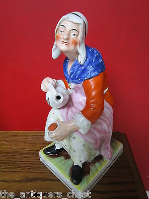 Antique Staffordshite England sculpture figurine of a lady pourring tea on cup