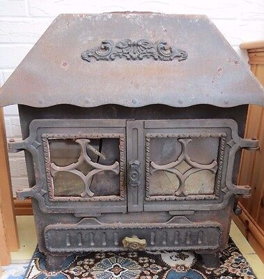 Antique wood burner canopy style 2 doors requires restoration new glass seal etc