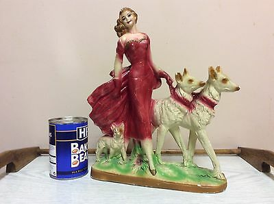 A Santini Art Deco plaster/chalkware Figurine Lady with 3 dogs