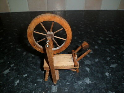 small wooden spinning wheel