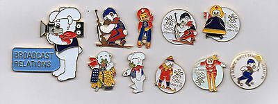 Great collection of 10 mascot pins from Calgary 1988 winter games - big camera