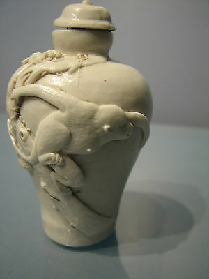 A beautiful chinese white snuff  pot with monkey figure in relief