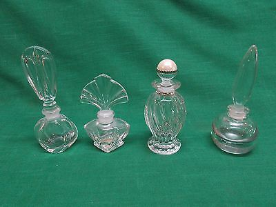 Lot of 4 empty perfume bottles clear glass crystal. Glass stoppers.