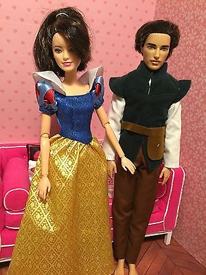 Lot of (2) Ken and Barbie dolls. Articulated.