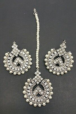 New Elegant Manjoos Earrings and tikka set in silver and pearl
