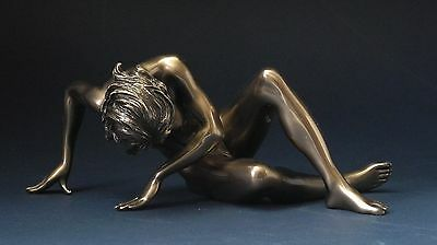 Beautiful Erotic Sculpture of a Woman stretching. Art, Gift, Ornament.