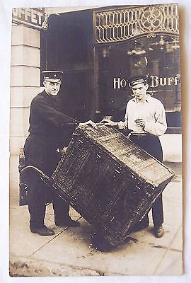 RPPC antique real photo postcard hotel bellhop and large luggage trunk 1900's