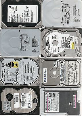 Lot of 8 Hard drives unchecked, for parts or metal recovery see scans.