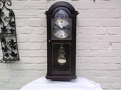 A Wall Clock 31 Day Mechanical (Wooden) Gongs The Hour And The Half