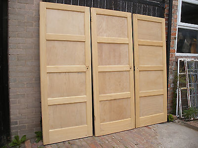 Reclaimed four panel 1930s to 1950s stripped pine doors.  (8 available)