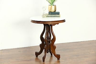 Victorian Oval Marble Top 1880's Antique Carved Walnut Parlor or Lamp Table