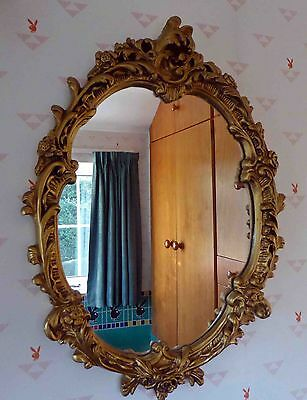 Oval Wall Mirror with gilded plaster frame