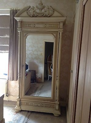 antique french armoire with beautiful carved cherubs