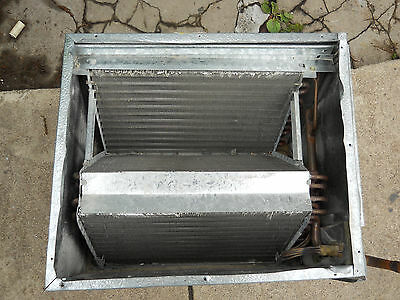 Air conditioner cooling section for furnace enclosure. Conditioning coil