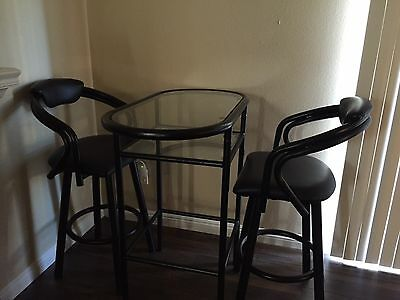 Glass table set with metal barstool and black vinyl seat