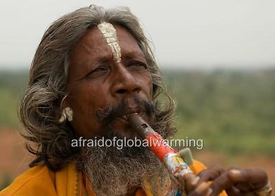 Photo. 2000s. Orchha, India.  Old Man Playing Flute