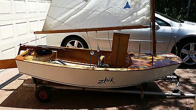 Sabot wooden vintage sailing dinghy, boat yacht, including beach trolley.