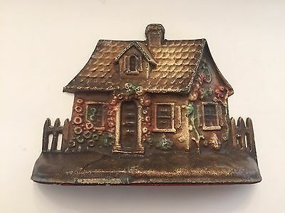 Old Cast Iron Cottage or House with Flowers Doorstop