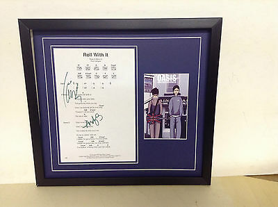 Oasis Genuine Hand Signed/Autographed Songsheet with a Postcard & COA